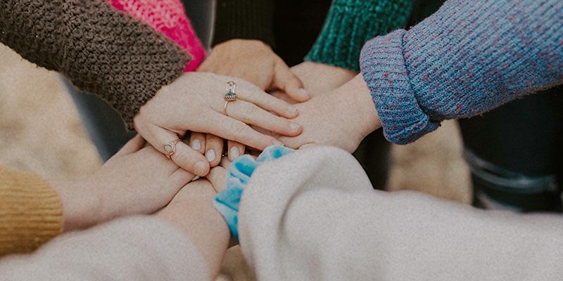 Hände zusammen Mitarbeit